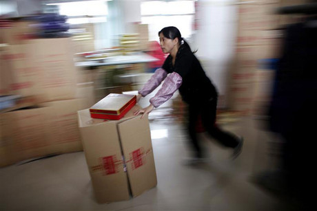 Factory workers in China are likely to get a boost (Reuters)