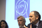 Guido Tonelli (R), CMS experiment spokesperson, next to Rolf Heuer (C), CERN Director General (Reuters file)