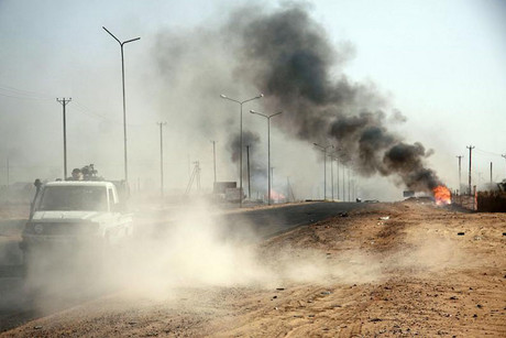 Smoke from explosions is seen during clashes between rival militia in Sabha, Libya  (Reuters)