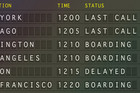 The board features 'split flap' flight information