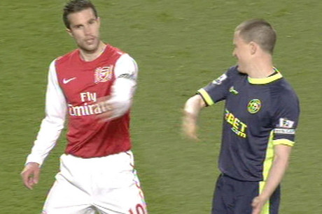 Robin van Persie swats Gary Caldwell's offer of a handshake away
