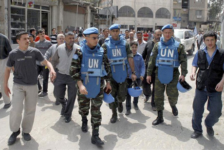 Moroccan Colonel Ahmet Himmiche (3rd L), leader of the first UN monitoring team in Syria, during a visit with his team to one of Damascus' suburbs (Reuters)