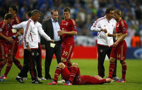 Bayern players gutted after the shootout (Reuters)