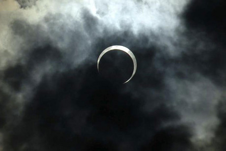The moon passes between the sun and the earth during an annular solar eclipse over the skies of the Rift Valley town of Nakuru, Kenya (Reuters)