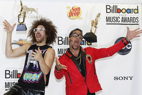 Redfoo and SkyBlu of LMFAO pose with their awards backstage (Reuters)