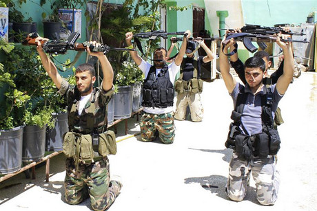 Free Syrian Army fighters attend daily training before commencing patrolling and frontline duties (Reuters)