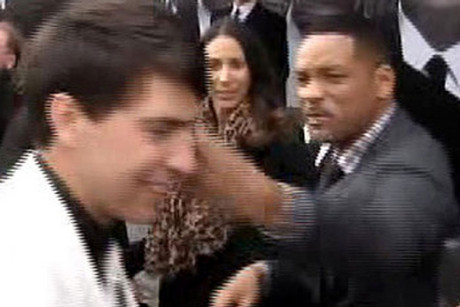 Will Smith slapping Ukrainian reporter Vitalii Sediuk