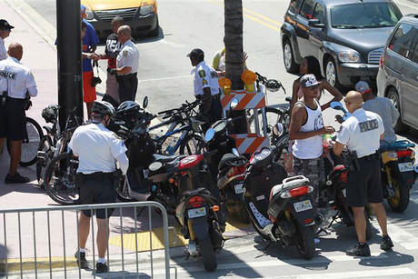 Police keep guard during the Urban Beach Weekend on Miami's South Beach (Reuters)