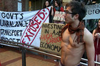 The group of protestors stripped down to their undies for the train ride and the semi-occupation of the train station