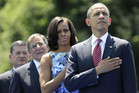 US President Barack Obama (R) stands with his wife Michelle Obama (2nd R), Defense Secretary Leon Panetta and Veterans Affairs Secretary Eric Shiseki (L) (Reuters)