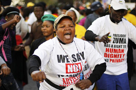 Supporters of the ruling ANC party demonstrate against the showing of a painting by artist Brett Murray (Reuters)