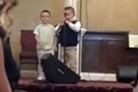 The young boy singing at the Apostolic Truth Tabernacle Church