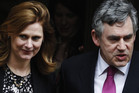 Britain's former Prime Minister Gordon Brown and wife Sarah leave the Leveson Inquiry (Reuters)