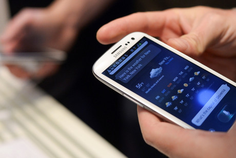 Participants could simply wave their phone over the terminal to pay (file: Reuters)