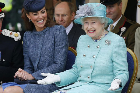 Catherine, Duchess of Cambridge laughs as Queen Elizabeth gestures (Reuters)