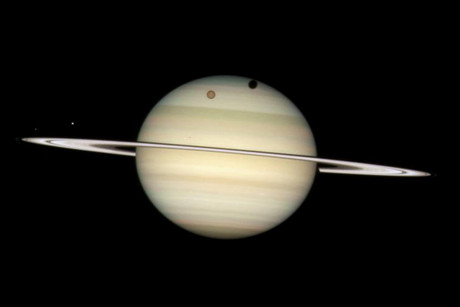 The four moons of Saturn passing in front of their parent planet, captured by NASA's Hubble Space Telescope (Reuters)