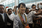 Myanmar's pro-democracy leader Aung San Suu Kyi makes her way through the Yangon International Airport as she leaves for her trip to Europe (Reuters)