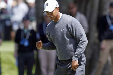 Tiger Woods celebrates birdie on the fourth hole