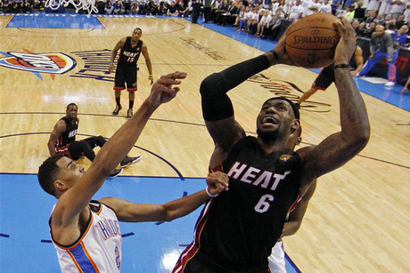 Miami Heat's James shoots around Oklahoma City Thunder's Sefolosha (Reuters)