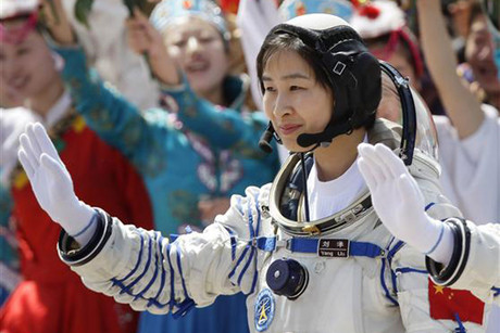China's first female astronaut Liu Yang waves during a departure ceremony at the Jiuquan Satellite Launch Center (Reuters)