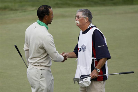 Tiger Woods shakes hands with his former caddie Mike Cowan on the 18th green during the third round of the 2012 U.S. Open golf tournament on the Lake Course at the Olympic Club in San Francisco (Reuters)