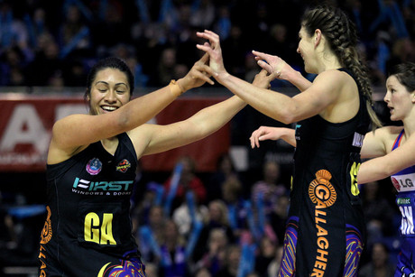 Magic's Irene van Dyk high fives with Julianna Naoupu (Photosport)