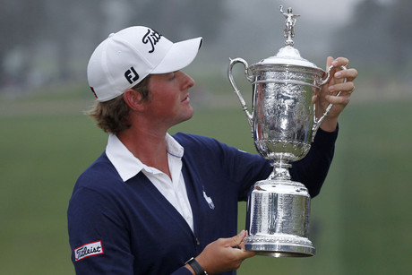 Webb Simpson with his US Open trophy (Reuters)