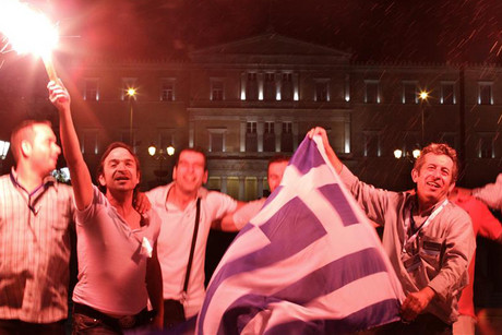 New Democracy supporters celebrate in front of the parliament in central Athens (Reuters)