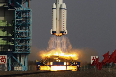 The Long March II-F rocket loaded with a Shenzhou-9 manned spacecraft lifts off (Reuters)