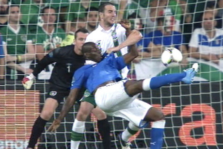 Mario Balotelli volleys to score for Italy