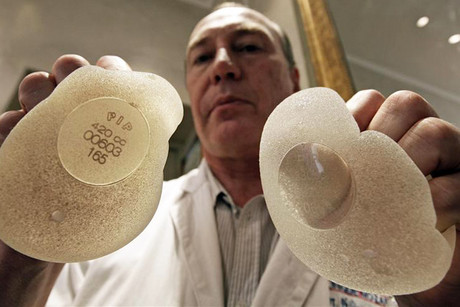 Plastic surgeon Denis Boucq with silicone gel breast implants manufactured by French company Poly Implant Prothese (PIP) (Reuters)