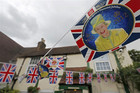 Images of B ritain's Queen Elizabeth and Union flag bunting hangs across The Jubilee pub ahead of the Queen's diamond jubilee celebrations in Sunbury-on-Thames in south west London (Reuters)
