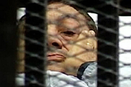 Former Egyptian President Hosni Mubarak is seen in the courtroom for his trial at the Police Academy in Cairo (Reuters file)