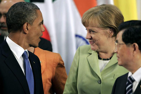 US President Barack Obama (L) and German Chancellor Angela Merkel (C) with China's President Hu Jintao (R) at the G20 Summit (Reuters)