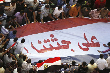 Supporters of the Muslim Brotherhood celebrate and shout anti-military council slogans in Tahrir square (Reuters)