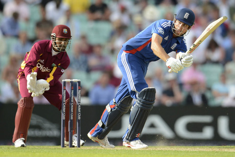 England's captain Alastair Cook (right) bats as West Indies' Denesh Ramdin watches (Reuters)