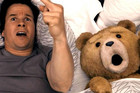Mark Wahlberg with his toy Ted in the movie Ted