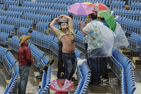 Optimistic cricket fans enjoy the rain at Headingley (Reuters)