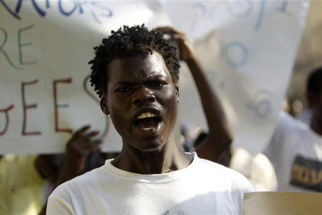 A Sudanese man shouts slogans during a protest  (Photo: Reuters)