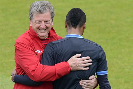 Roy Hodgson (L) in a loving embrace with Ashley Cole (R) (Reuters file)
