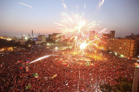 Fireworks explode as supporters of Muslim Brotherhood's presidential candidate Mohamed Morsi celebrate his victory in the election at Tahrir Square (Reuters)
