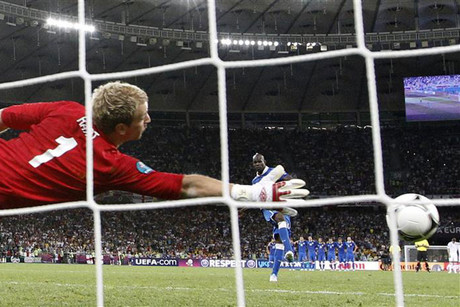Mario Balotelli puts one past England 'keeper Joe Hart in the penalty shoot-out (Reuters)