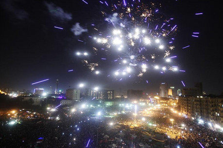 Fireworks explode as supporters of Muslim Brotherhood's president-elect Mohamed Morsi celebrate his victory (Reuters)