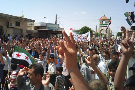 Demonstrators protest against Syria's President Bashar Assad in Tamanna, near Idlib (Reuters)