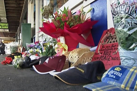Flowers, balloons, cards and other memorial items left outside Jordan Voudouris' shop on Saturday night were vandalised