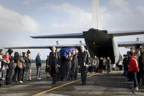 William Delamere's body arrives in New Zealand, met by navy personnel, friends and family