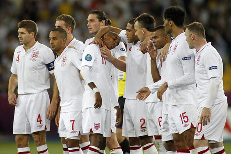 England's Young is consoled by team members after missing a penalty during the game  (Photo: Reuters)