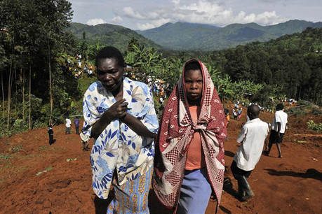 Relatives arrive at the scene of a landslide in Nalenda village (Reuters)