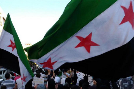 Demonstrators protest against Syria's President Bashar Assad in Jubar near Damascus (Reuters)