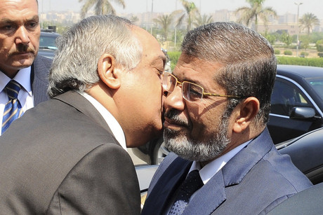 Egypt's Interior Minister Mohammed Ibrahim (L) with President-elect Mohammed Morsi (Reuters)